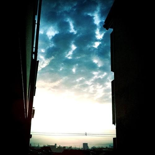 夕暮れの風景。建物の間から…。 #evening