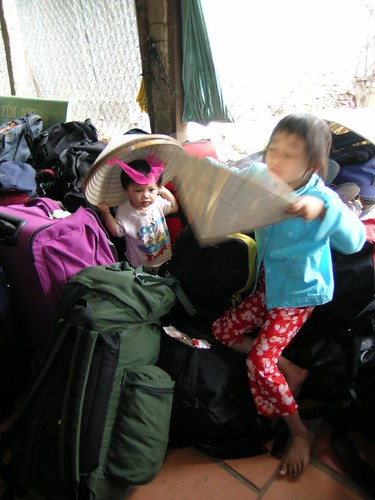 Children playing in our luggage