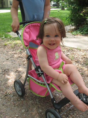 baby in a dolly stroller