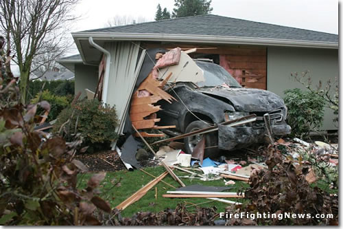 Car Crashes Through Home by FireFightingNews.com.