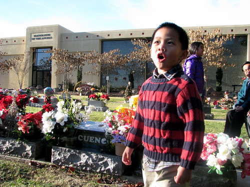 My nephew Ethan singing at my grandfather's grave Christmas Day