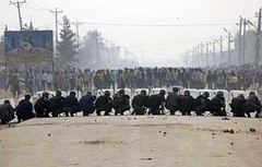 Police take position as they block a road in Birjung, about 200 km (124 miles) south of Kathmandu, February 15, 2008.