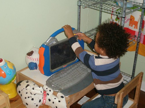 "Setting up his ""laptop"""
