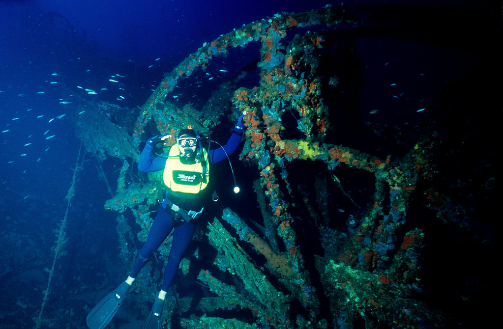 Byron at -50 meters salutes the paddlewheel of PATRIS, sunk in 1868 after hitting the reef of Koundouros