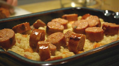 layering andouille into cassoulet