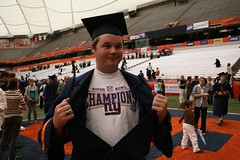 He wore his Giants shirt under his cap and gown...