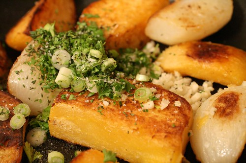 Herbs over the fried turnips and rutabaga