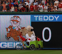 Washington Nationals racing presidents Teddy Roosevelt and Thomas Jefferson ride the anchor leg of a presidents race relay at Nationals Park