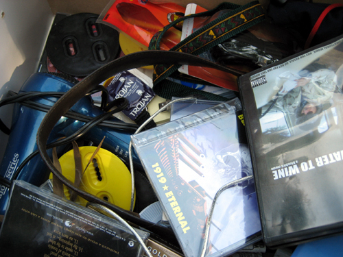 Junk drawer with CDs and condoms