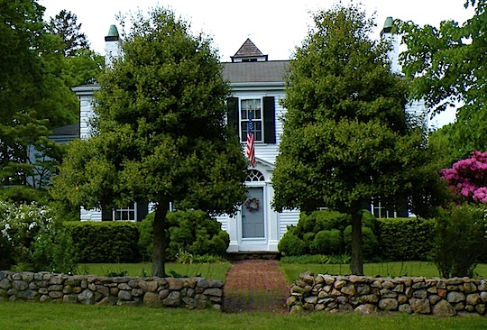 White clapboard antique house on 6A in Barnstable MA