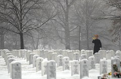 Taps is played on the bugle in the winter snow...