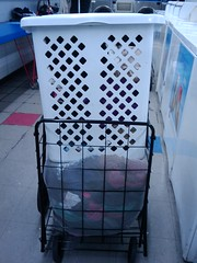 Then you have to fit both the laundry basket and the big mesh bag into your hand cart.