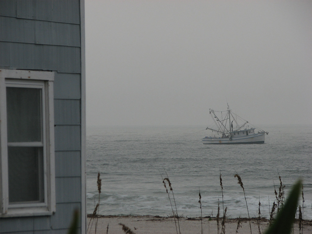 A shrimp boat trolling the shore line.