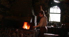 Blacksmith working the bellows