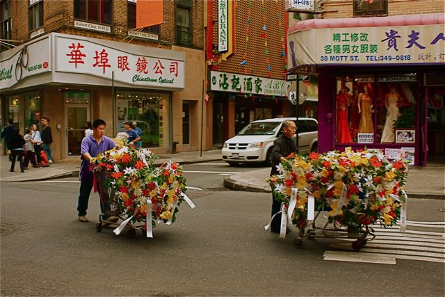 Ceremonial wreaths en-route to a traditional chinese funeral
