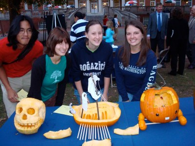From left: Juniors Lua Cao and Emily Beste (Third Place), Senior Emily Potosky (First Place) and Senior Kathleen Watson (Second Place) pose behind their pumpkins. The winners recieved $50, $30, and $20 gift cards to Target from Sodexho, who hosted the event.