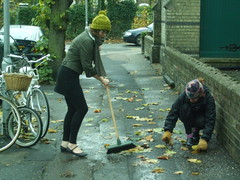 Sweeping up street leaves for making into leaf...