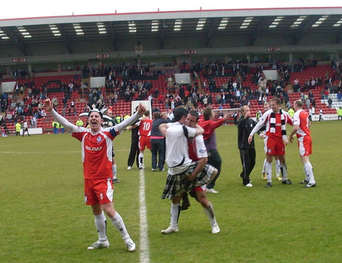 Ayr players and fans celebrate