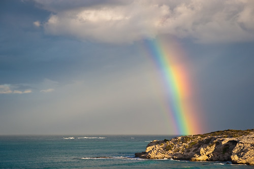 A rainbow over the cliffs at Arniston/Waenhuiskrans