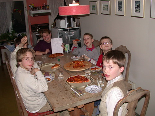 My son (the 11) and friends eating homemade pizza together