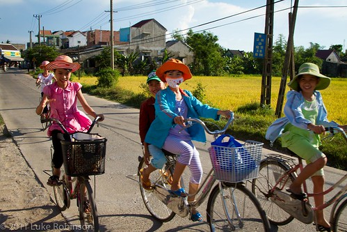 Bicycle kids, outside Hoi An
