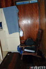Our chairs and TV used to block the front door from future robberies at 3am at the River Guesthouse