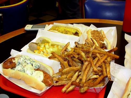 Clockwise from lower right: duck fat fries, Spicy Smoked Alligator Sausage with Cajun Remoulade and St. Petes Blue Cheese, Irish Banger with Goose Island Honkers Ale Mustard and Irish Harp Cheddar Cheese, Jamaican Jerk Pork Sausage with Spicy Mango-Passion Fruit Mayonnaise and Roasted Plantains, Ribeye Steak Sausage with Horseradish Cream Sauce and Crispy Fried Onions.
