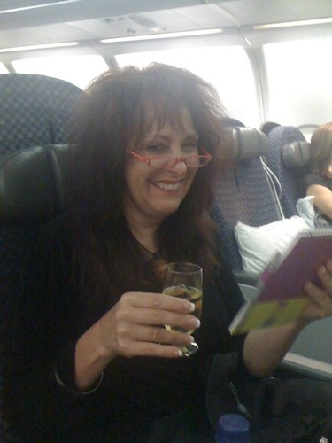 Wine service and my dorky reading glasses enroute toamsterdam
