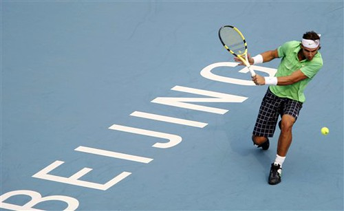 Spains Rafael Nadal returns the ball to Croatias Marin Cilic during the semi-finals of the China Open tennis tournament in Beijing Saturday, Oct. 10, 2009. Cilic beat Nadal 6-1, 6-3. (AP Photo/Elizabeth Dalziel)