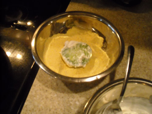 Then, dredge through cornmeal mixture.