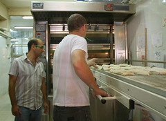Conveyor belt moves the raw baguettes into the oven