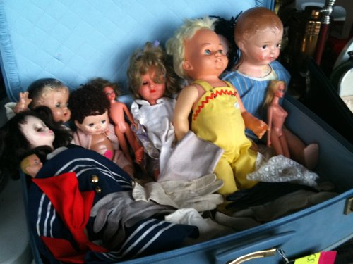 Dolls in a suitcase