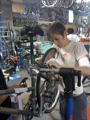 Kristin working on some brakes.