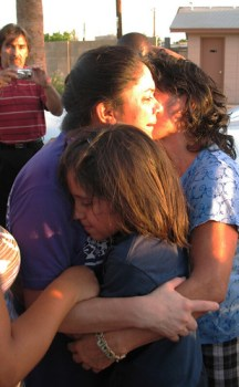 Sandra hugs her daughter Katherine, her mother Mercedes and her sister Griselda after being released by Customs and Immigration Enforcement.