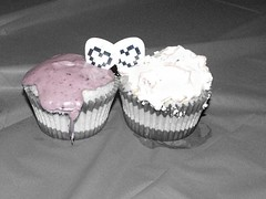 Cupcakes with pixel heart guitar picks.