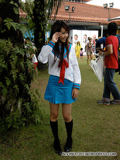 It helps to be pretty - this girl in a simple sailor uniform was attracting hounds of photographers