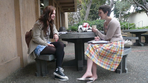 Campus Chic's Chloe Schildhause chats with the stylish Lucy Hamilburg outside University Center about her outfit and fashion inspiration.  Photo by Sky Madden/Foghorn