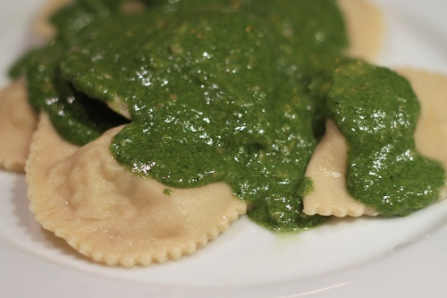 crab ravioli in herb sauce, in various stages of constructions