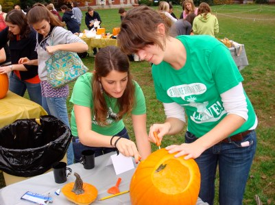 From left: exchange students Manon Vernier and Julia Preuß work on their pumpkin.