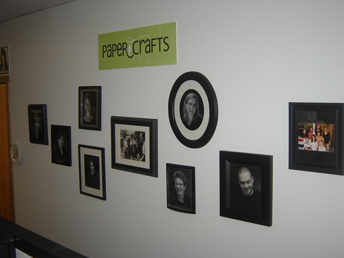 With our bellies full, its time to go back to work. Lets head down this hallway to Jennifers office. On this wall youll see all of our black and white headshots.