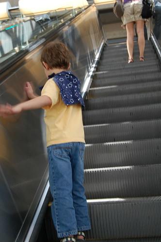 superhero uses escalator