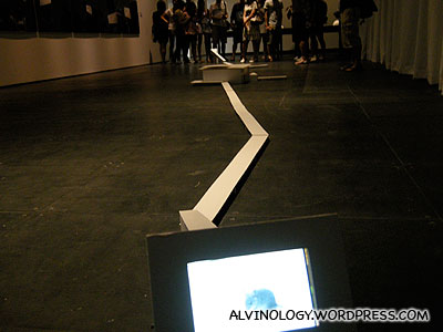 An interactive video installation that features a rat which will run from one screen to another as a person approaches either side of the work