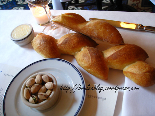 Bouchon - bread (pain epi) and warmed pistachios