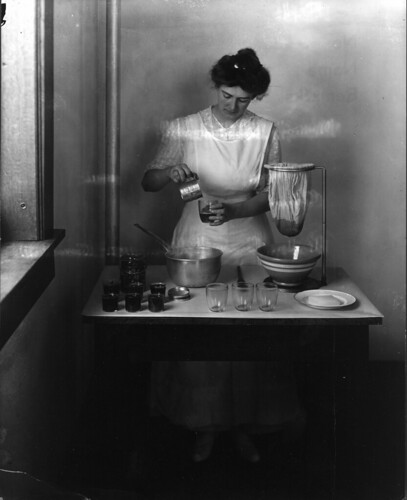 Demonstration of making rhubarb jelly. Photo taken by Troy in 1916 for Miss Canon, ...