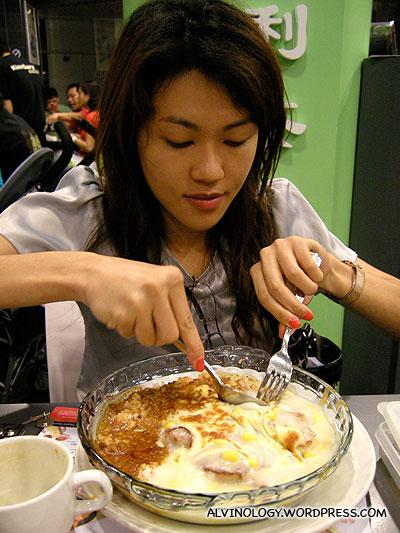 Rachel tucking into her baked rice