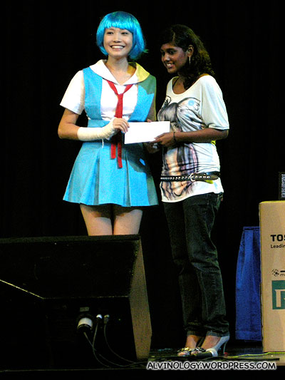 Dawn Yeoh giving out the prize for a Japanese songs singing competition