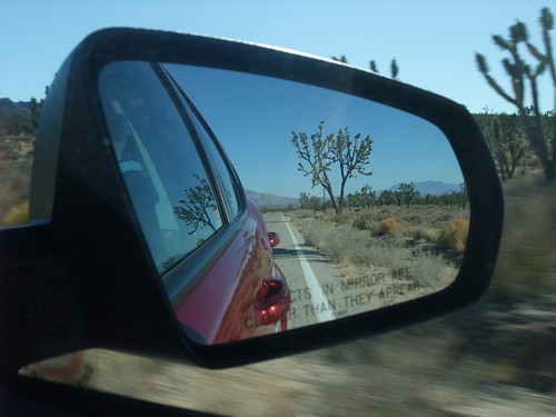 Desert road in car mirror