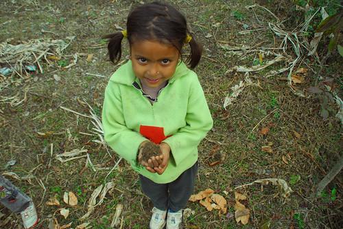 girl holding dirt