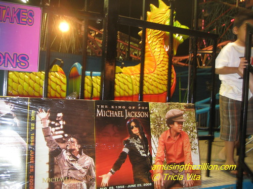 Michael Jackson tribute posters on front of Neverlands Dragon Wagon Kiddie Coaster in Coney Island. Photo © Tricia Vita/me-myself-i via flickr