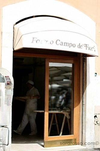 Pizza going in the oven, Forno Campo de Fiori, Rome, Italy
